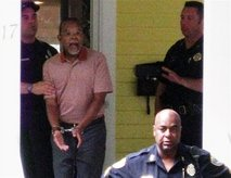 Gates being arrested. Note the black police officer in the foreground.