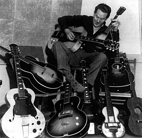 Les Paul with his guitars